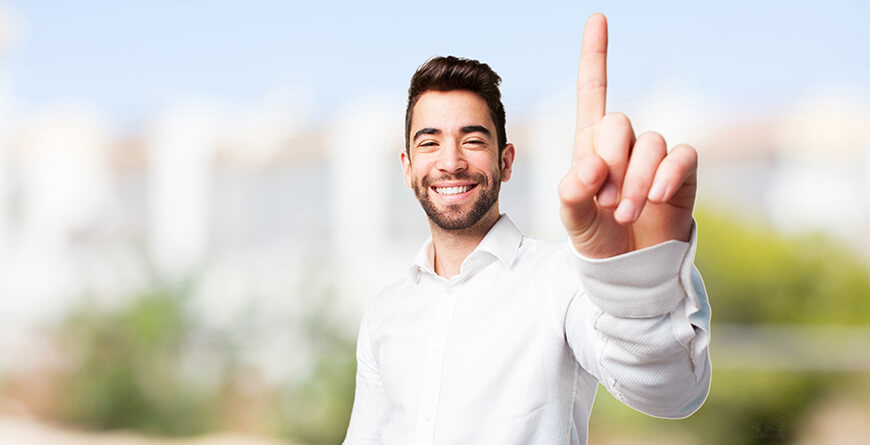 Man holding one finger up in the air