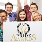 People holding sign up for pride awards